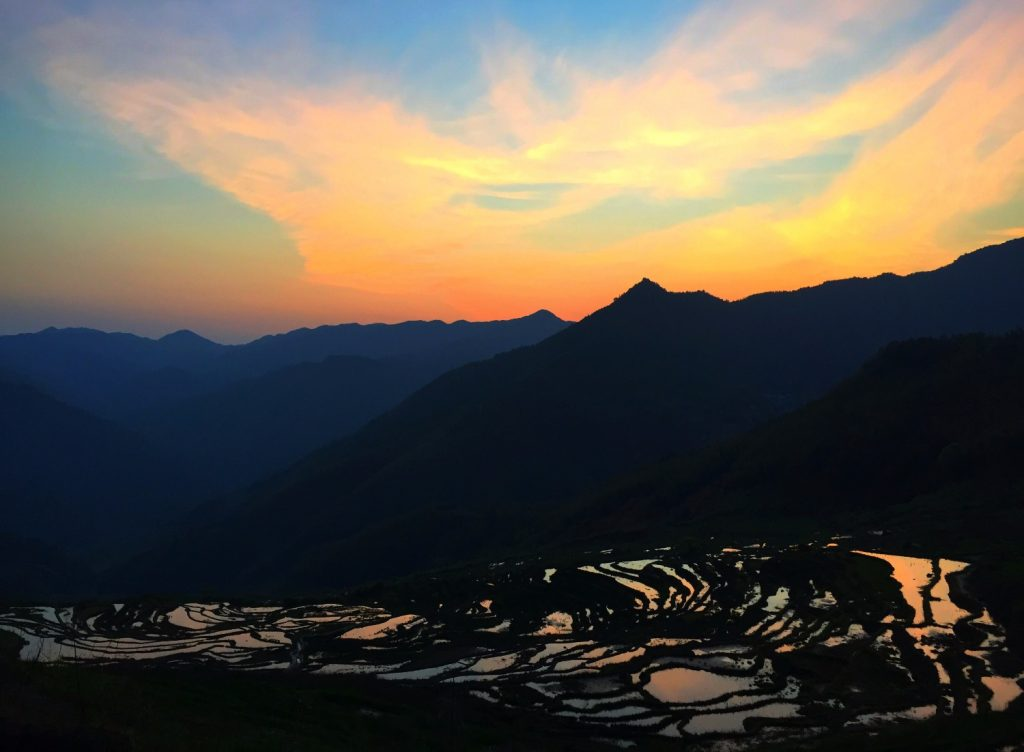 sunset colors over rice terraces in fujian province